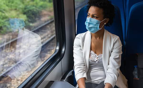 masked woman on train